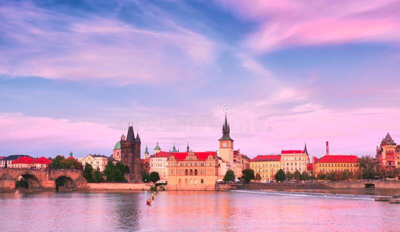 Prague, riverside on sunset, with Charles Bridge on the right and historic skyline in front. Prague, riverside on sunset, with Charles Bridge on the right and royalty free stock photography