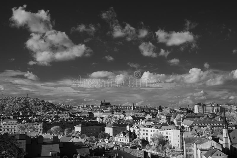 Prague skyline with St. Vitus Cathedral in the background. Black and white infrared photography - Prague skyline with St. Vitus Cathedral in the background stock images