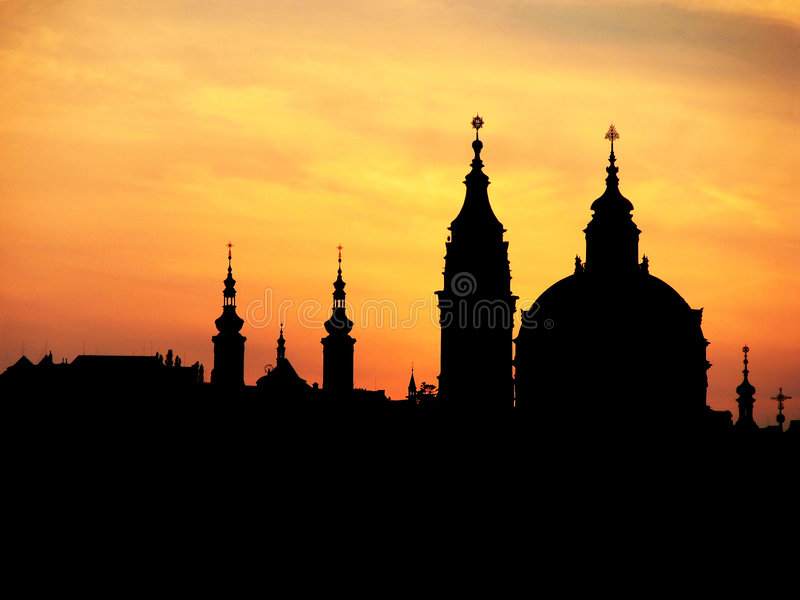 Prague spires. In the sunset light, silhouette stock photography