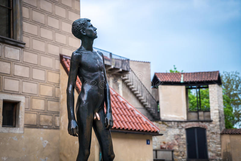 PRAGUE statue of nude young man. PRAGUE, CZECH statue of a young naked nude man close to Prague Castle Eastern gate stock images