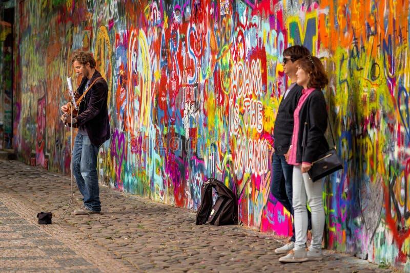 Prague Street Busker Performing Beatles Songs at John Lennon Wall royalty free stock photos