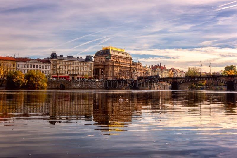 Prague view of historic buildings, theatre and Legions bridge over the Vltava river, sunset cityscape stock images