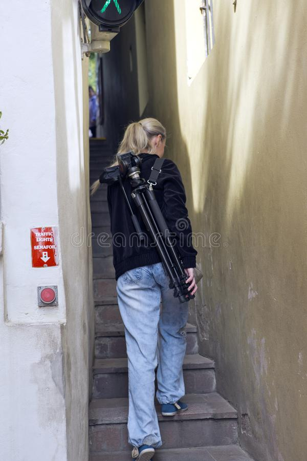 Prague. The woman on the narrowest street with the traffic light for pedestrians and one-way traffic stock photography