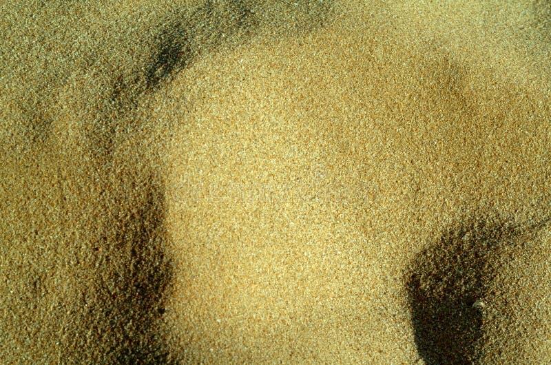 Praia da areia da textura imagens de stock