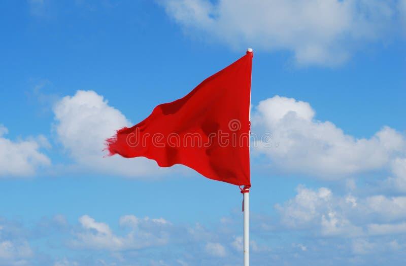 Praia da bandeira vermelha fotografia de stock