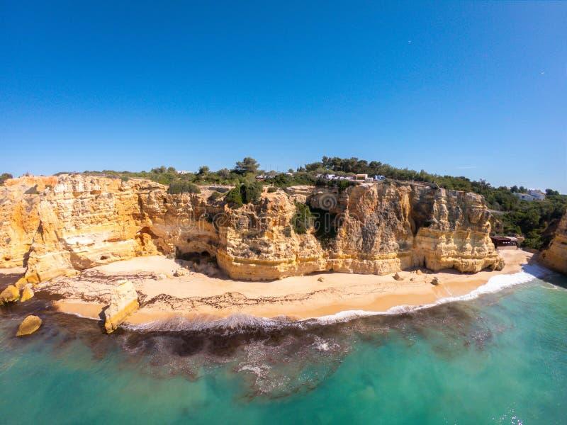 Praia De Marinha Most beautiful beach in Lagoa, Algarve Portugal. Aerial view on cliffs and coast of Atlantic ocean royalty free stock photos
