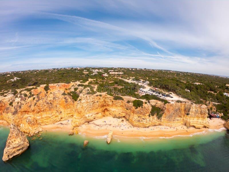 Praia De Marinha Most beautiful beach in Lagoa, Algarve Portugal. Aerial view on cliffs and coast of Atlantic ocean royalty free stock photo