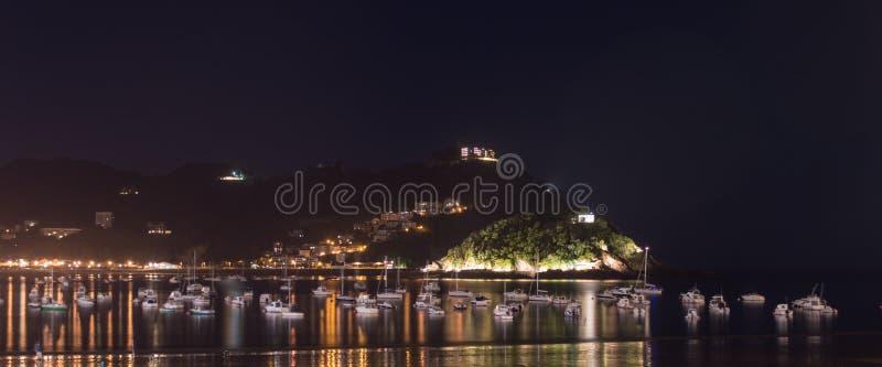 Praia de San Sebastian na noite imagens de stock royalty free