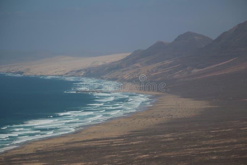 Praia descascada imagens de stock