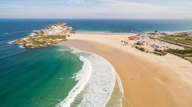 Praia do Campismo and Island Baleal naer Peniche on the shore of the ocean in west coast of Portugal stock image