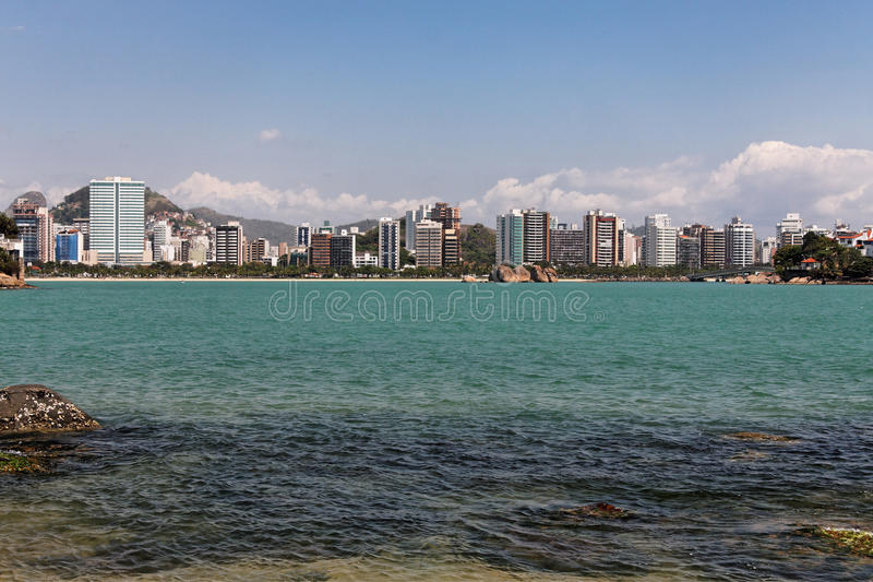 Praia do Canto Vitoria. The buildings, the rocks, the sand and the green water of the Atlantic Ocean in Praia do Canto, Vitoria, Espirito Santo state, Brazil royalty free stock photo