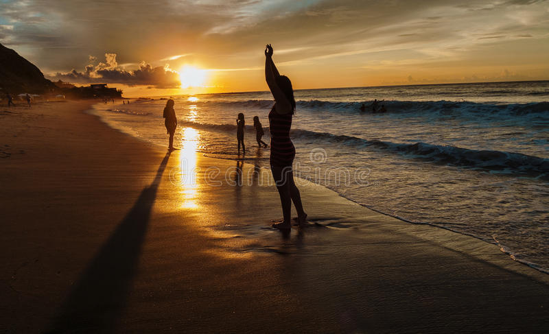 Praia do por do sol foto de stock