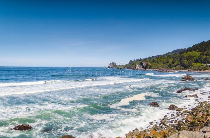 Praia e céu fotografia de stock royalty free