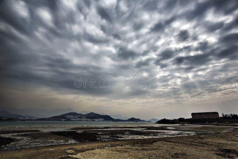 Praia e por do sol fotografia de stock royalty free