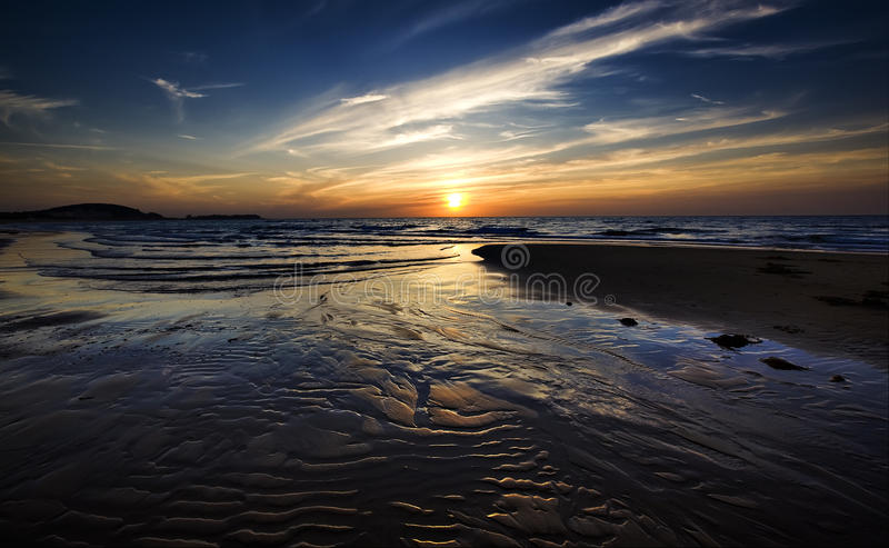 Praia e por do sol imagem de stock royalty free