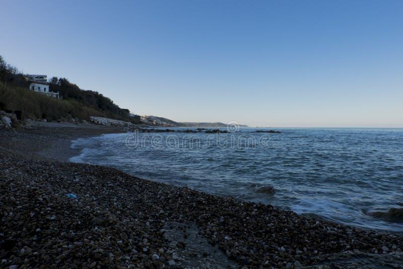 Praia, no por do sol imagens de stock