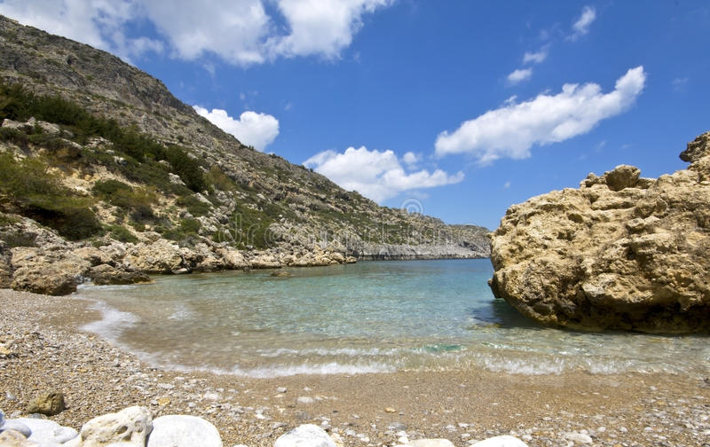 Praia no Rodes, Greece (Anthony Quinn) foto de stock royalty free