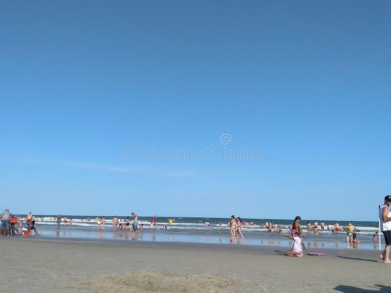 Praia słońca plażowy niebieskie niebo zdjęcia stock