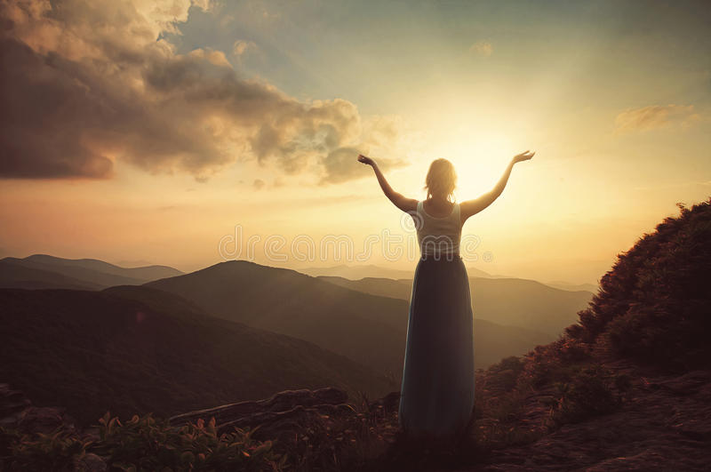 Praise on top of the mountain royalty free stock photo