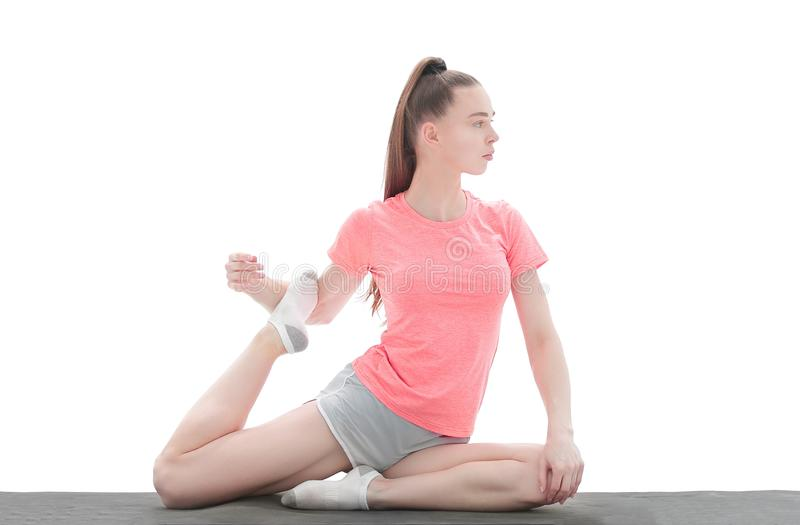 Praktyka joga młoda kobieta odziewa stażową joga pozycję w sportach zdjęcia stock