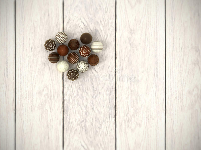 Praline Easter eggs heart on white wooden floor - top view royalty free stock photography