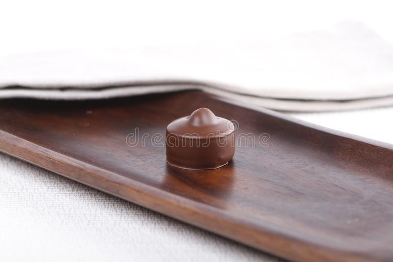 Praline on a wooden board royalty free stock photography
