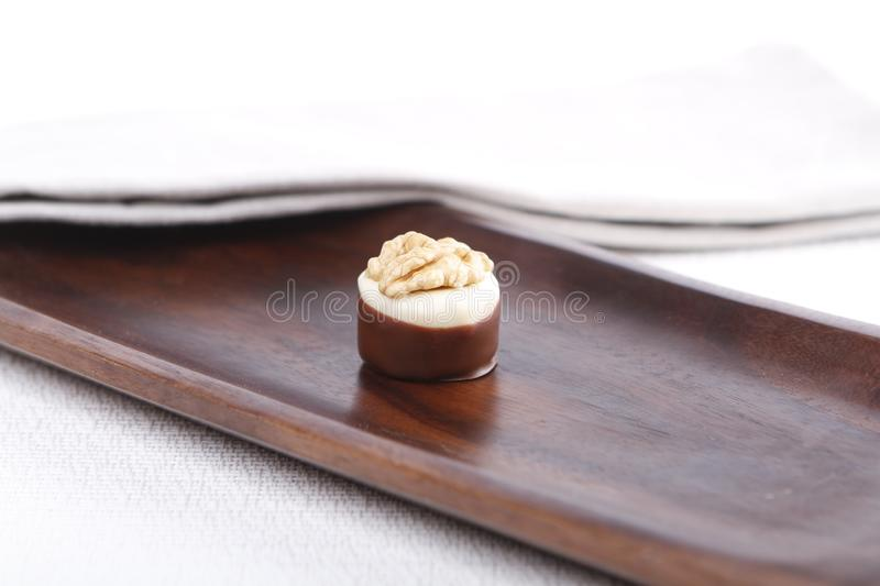 Praline on a wooden board royalty free stock images