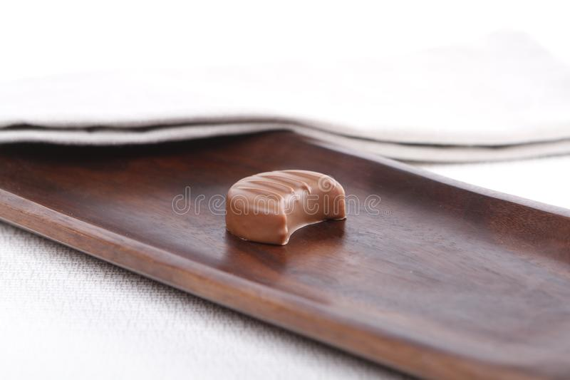 Praline on a wooden board royalty free stock photo
