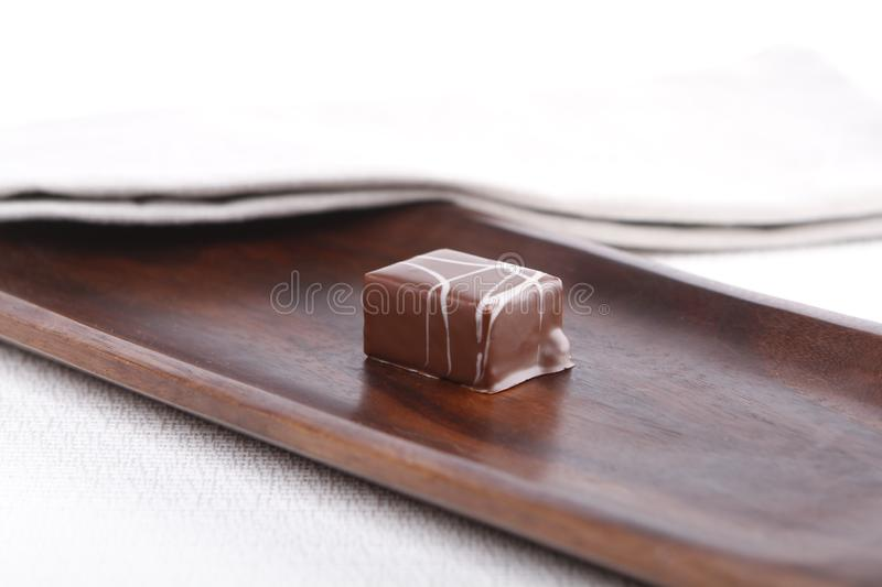 Praline on a wooden board royalty free stock photos