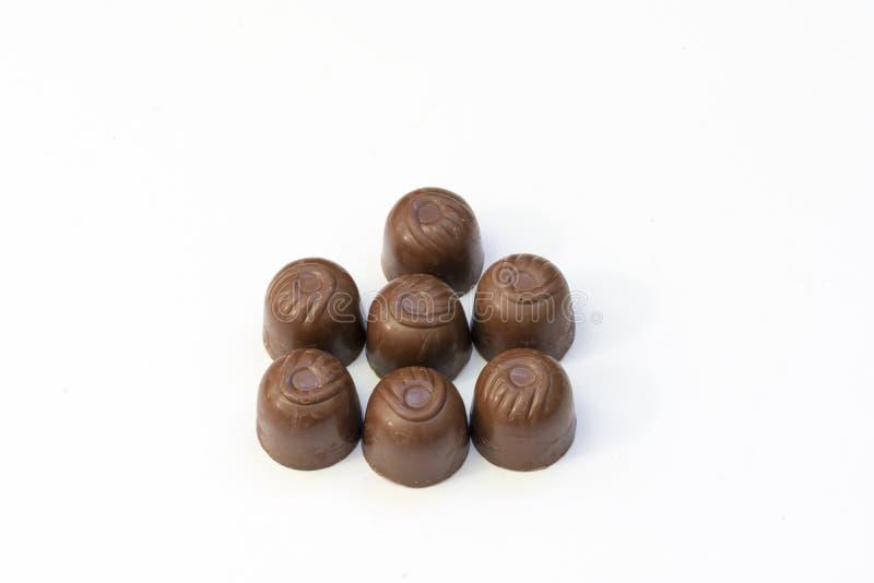 pralines предпосылки изолированные шоколадом белые стоковая фотография rf