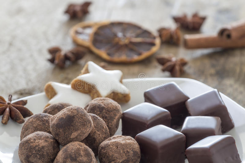 Pralines of Chocolate and marzipan and cinnamon stars stock images