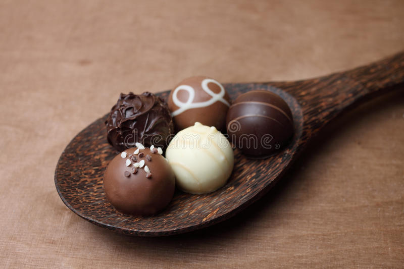 Pralines on a spoon stock image