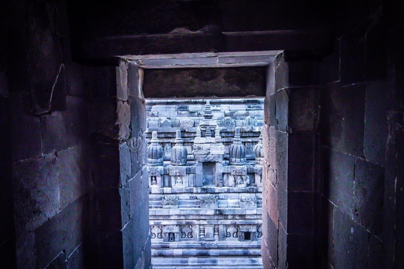 Prambanan Temple, Yogyakarta, Indonesia. Doorway inside Prambanan Temple in Yogyakarta, Indonesia looking at carved statuary in courtyard royalty free stock images