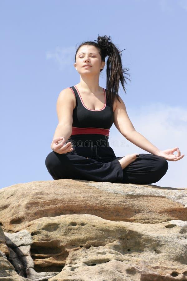 Pranayama (vertical). Practising controlled breathing exercises - yoga stock photo