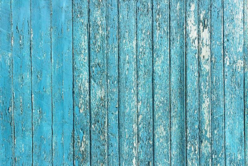 Pranchas de madeira descascadas velhas com pintura rachada da cor, painéis velhos do fundo imagem de stock