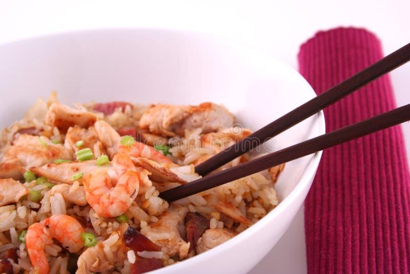 Pranzo del riso con le bacchette fotografia stock
