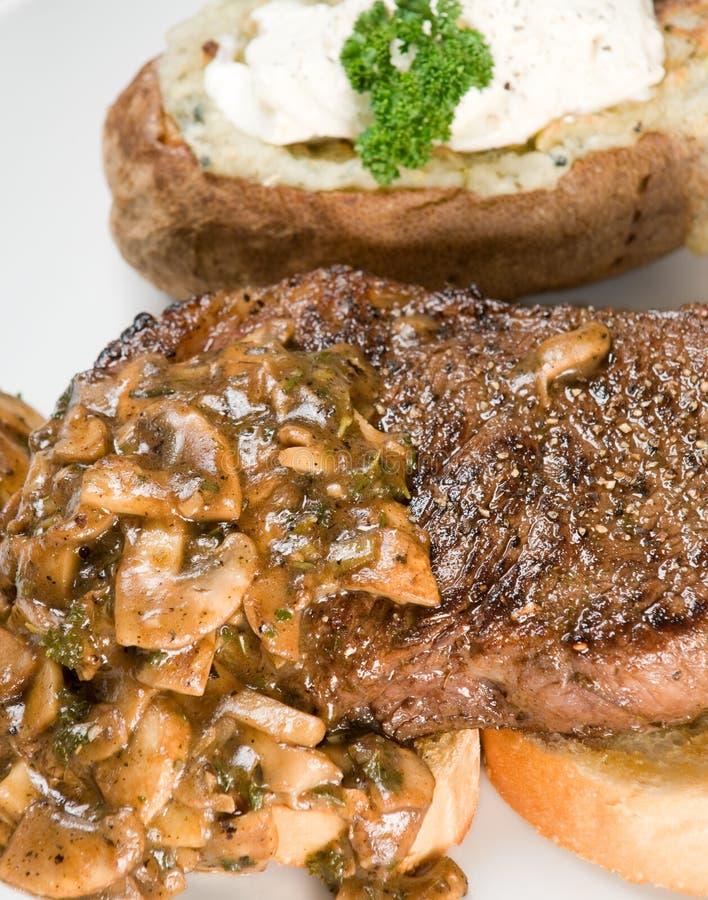 Pranzo della patata e della bistecca fotografia stock
