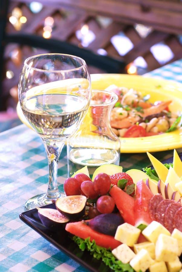 Pranzo e vino immagine stock