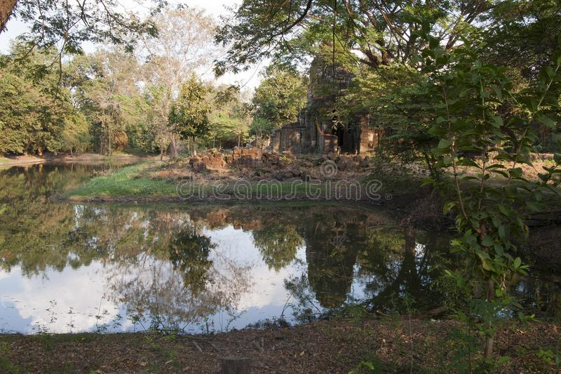 Prasat Ta Prohm temple tower with reflection in pond stock images