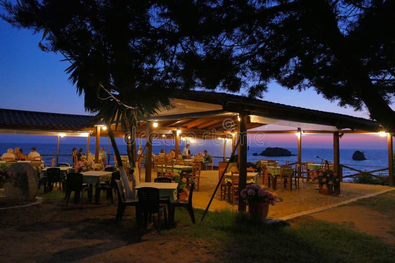 Prasoudi, Corfu, Greece, June 2019 Greek tavern where to eat with sea view. Prasoudi, Corfu, Greece, June 2019 Typical Greek tavern where to eat with sea view royalty free stock image