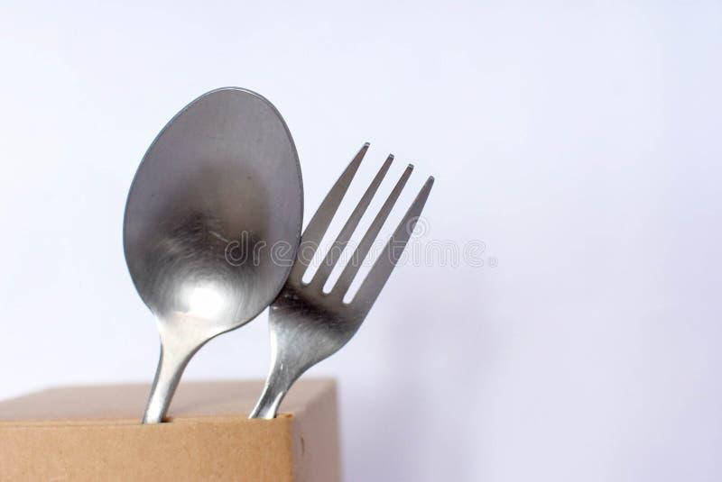 Pratica di acciaio inossidabile e del cucchiaio fotografia stock