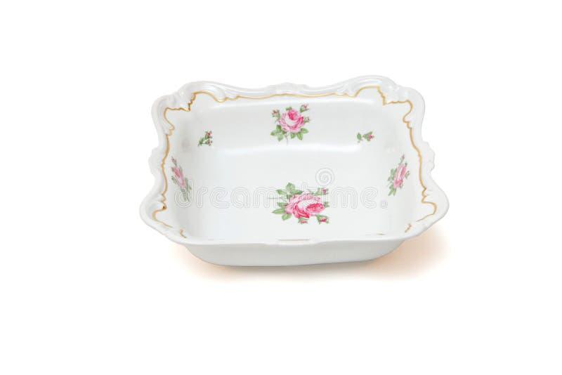 Prato de porcelana branco quadrado com as rosas isoladas imagens de stock