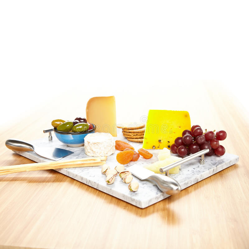 Prato de serviço de mármore com a variedade dos aperitivos fotografia de stock royalty free