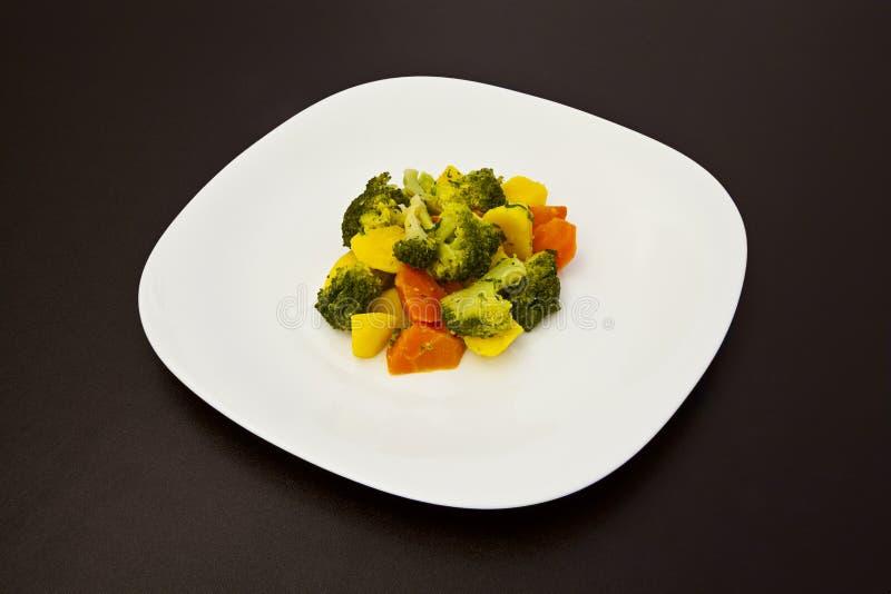 Prato de vegetariano em uma placa fotografia de stock
