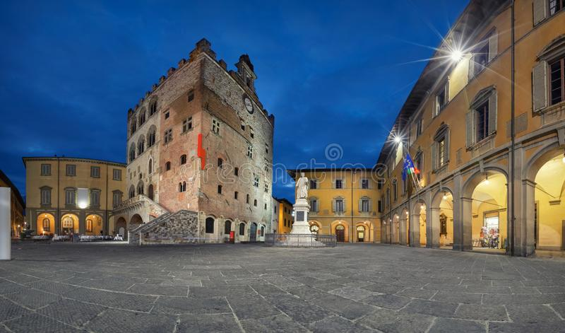 Prato, Italy. Panorama of Piazza del Comune square. With historic building of medieval Town Hall at dusk stock photos
