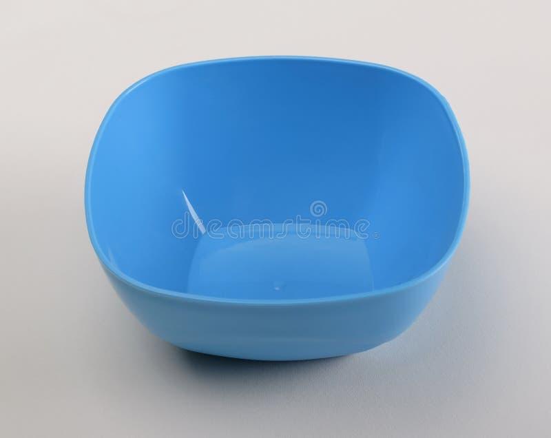 Prato profundo plástico azul imagens de stock royalty free