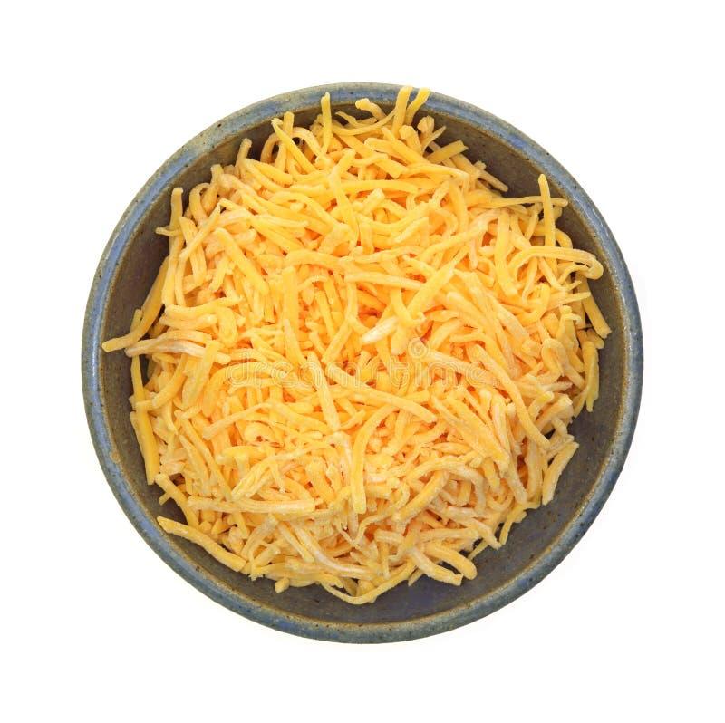 Prato Shredded do queijo cheddar fotografia de stock royalty free