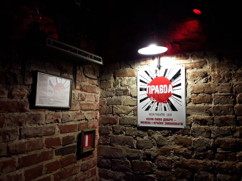 Pravda Stands for Truth Poster on Red Brick Wall in Cafe stock image