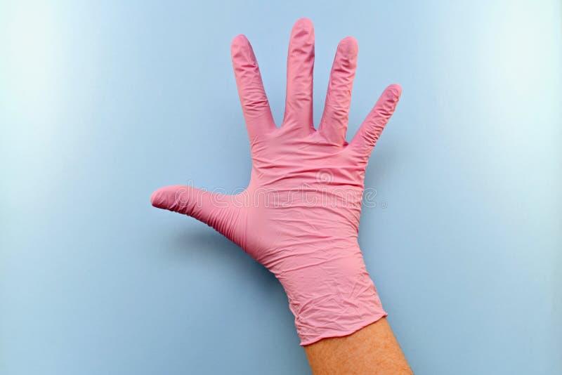 Prawa gloved ręka z zewnętrzną stroną ręka obraz stock