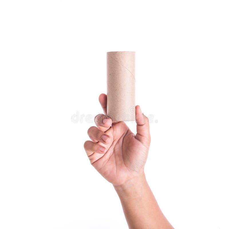 Prawa ręka mienie brown papieru tubka odizolowywająca na białym tle fotografia royalty free